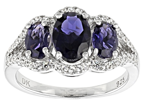 Photo of 1.62ctw Oval Iolite And .47ctw Round White Zircon Rhodium Over Sterling Silver 3-Stone Ring - Size 8