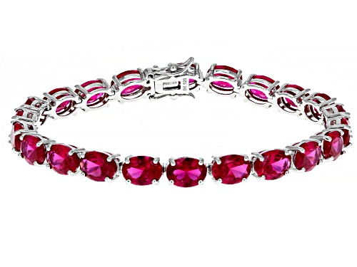 Photo of 26.13ctw Oval Lab Created Ruby Rhodium Over Sterling Silver Tennis BraceletT - Size 7.25