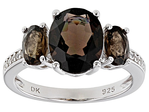 Photo of 2.78ctw Oval Smoky Quartz With .09ctw Round Zircon Rhodium Over Sterling Silver Ring - Size 7