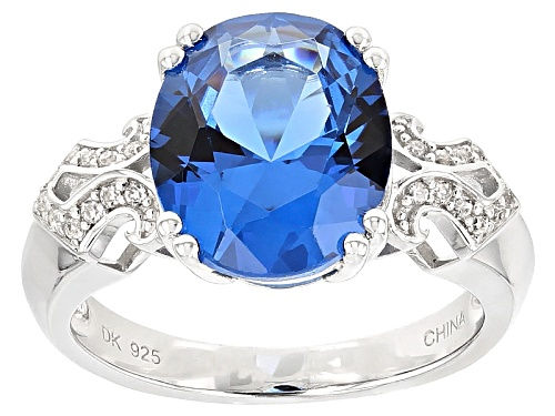 Photo of 4.25ct Oval Lab Created Blue Spinel And .09ctw Round White Zircon Sterling Silver Ring - Size 12