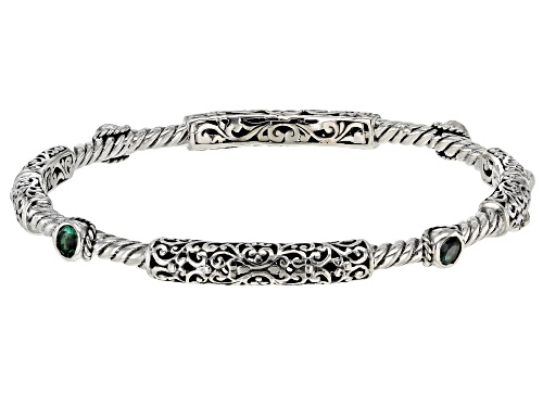 Photo of Artisan Collection Of Bali™ 1.00ctw 4mm Round Bali Hai™ Topaz Sterling Silver Bangle Bracelet - Size 7