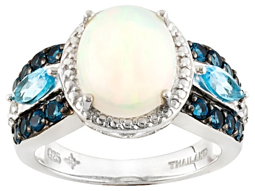 2.19ct Ethiopian Opal, 1.10ctw Swiss Blue And London Blue Topaz, .07ctw White Topaz Silver Ring - Size 8