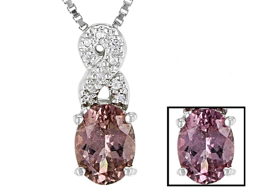 Photo of .85ct Oval Color Shift Garnet And .06ctw Round White Zircon Sterling Silver Pendant With Chain