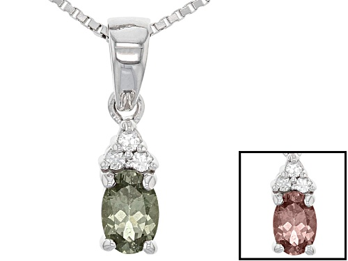 Photo of .48ct Oval Color Shift Garnet With .05ctw Round White Zircon Sterling Silver Pendant With Chain