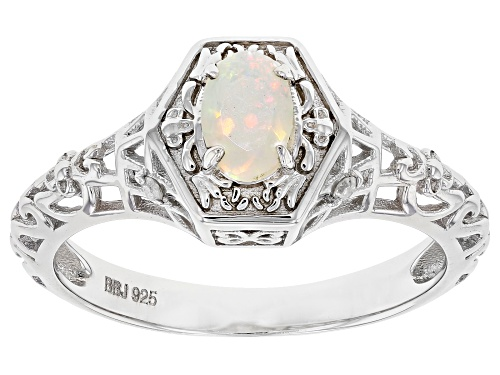 Photo of 0.31ct Oval Ethiopian Opal With 0.02ctw Round White Diamond Accent  Rhodium Over Silver Ring - Size 8