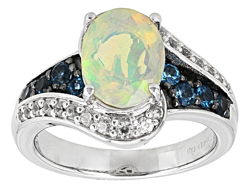 Photo of .93ct Oval Ethiopian Opal, .30ctw London Blue Topaz And .27ctw White Zircon Sterling Silver Ring - Size 8