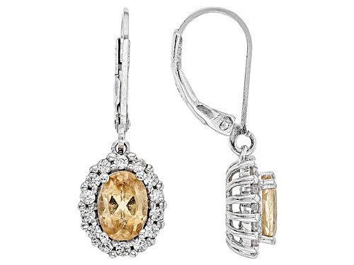 Photo of 1.52ctw Oval Imperial Hessonite™ And .53ctw Round White Zircon Sterling Silver Dangle Earrings