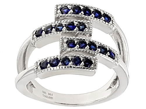 Photo of .76ctw Round Lab Created Blue Sapphire Sterling Silver Band Ring - Size 7