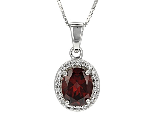 Photo of 3.25ct Oval Pomegranate Zircon With .18ctw Round White Zircon Sterling Silver Pendant With Chain