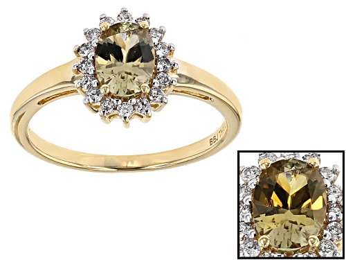 Photo of .65ct Oval Color Change Diaspore And .16ctw Round White Diamonds 14k Yellow Gold Ring - Size 12
