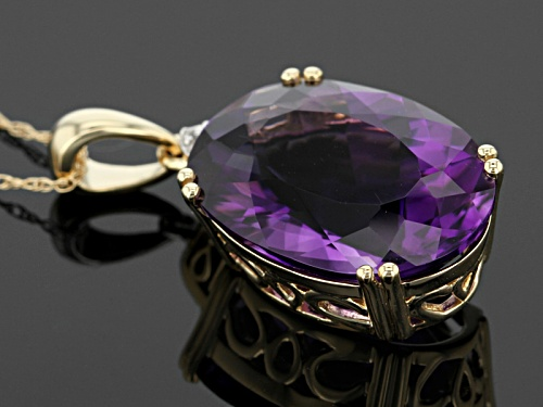 8.90ct Oval Uruguyan Amethyst And 0.02ctw Round White Zircon 14k Yellow Gold Pendant With Chain