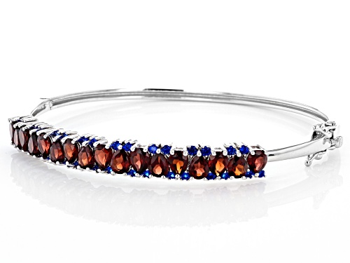 6.05ctw Pear Shape Vermelho Garnet(TM), .84ctw Lab Blue Spinel Rhodium Over Silver Bangle Bracelet - Size 8
