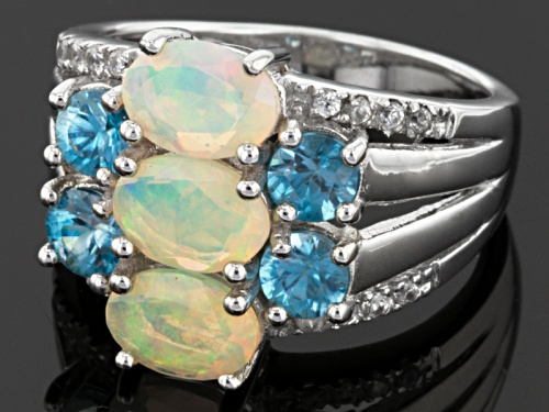 Pre-Owned 1.23ctw Oval Ethiopian Opal, 1.74ctw Round Blue Zircon And .13ctw Round White Zircon Silve - Size 7
