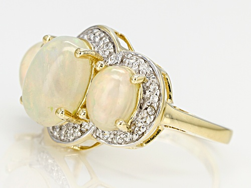 3.58ctw Oval Cabochon Ethiopian Opal And .19ctw White Zircon 10k Yellow Gold 3-Stone Ring - Size 8