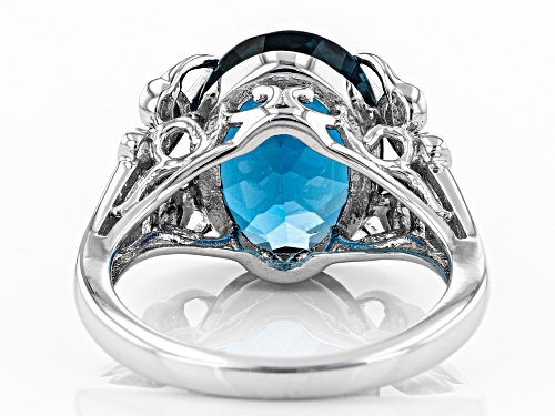 6.28CT OVAL LONDON BLUE TOPAZ WITH .04CTW BLUE DIAMOND ACCENT RHODIUM OVER SILVER RING - Size 9