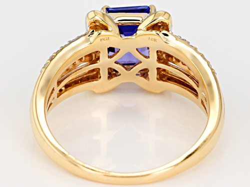1.36ct Emerald Cut Tanzanite with .34ctw Round White Zircon 10k Yellow Gold Ring. - Size 7