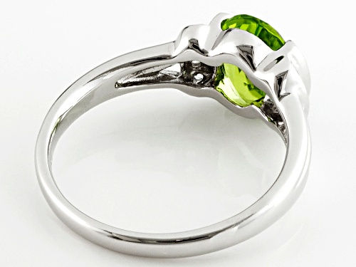 1.47ct Oval Manchurian Peridot™ And .06ctw Round White Zircon Sterling Silver Ring - Size 7