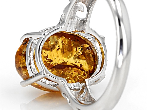 14x10mm Oval Cabochon Orange Polish Amber Solitaire Rhodium Over Sterling Silver Ring - Size 8