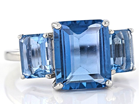 Blue color change fluorite rhodium over silver ring 6.72ctw