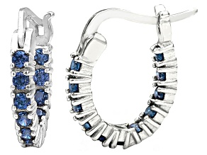 Bella Luce® 1.32ctw Tanzanite Simulant Rhodium Over Silver Oval Hoop Earrings