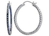 Bella Luce® 4.92ctw Tanzanite Simulant Rhodium Over Silver Oval Hoop Earrings