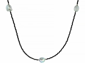 Black spinel  rhodium over sterling silver station necklace 35.00ctw