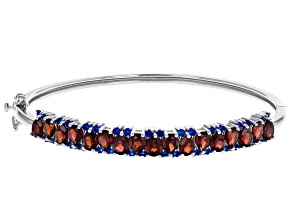 Red garnet rhodium over silver bracelet 6.89ctw