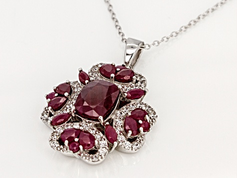 Red Indian ruby rhodium over sterling silver pendant with chain. 5.23ctw
