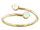 White Ethiopian Opal 10k Yellow Gold Bypass Ring .14ctw