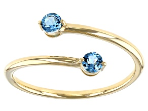 Swiss Blue Topaz 10k Yellow Gold Bypass Ring .29ctw