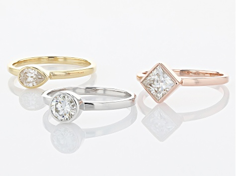 Moissanite platineve with 14k rose and yellow gold over silver ring set of three 1.93ctw DEW.