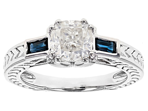 Moissanite Fire® 1.30ct DEW Cushion Cut With .34ctw Baguette Blue Sapphire Platineve™ Ring