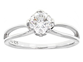 Moissanite Fire® .80ct DEW Round And .07ctw Round Blue Sapphire Platineve™ Ring