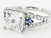 Moissanite Fire® 3.34ctw DEW And .11ctw Blue Sapphire Platineve™ Ring