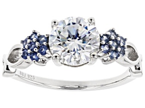 Moissanite Fire® 1.50ct DEW Round And .25ctw Round Blue Sapphire Platineve™ Ring