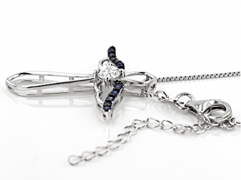 Moissanite And Blue Sapphire Platineve Cross Pendant.