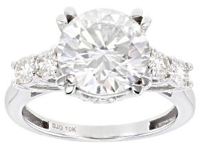 Moissanite 10k white gold engagement ring.