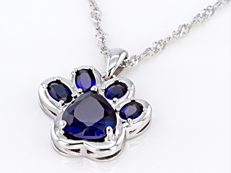 Blue lab created sapphire rhodium over silver paw print pendant with chain 2.56ctw