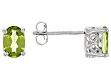 Green peridot rhodium over sterling silver earrings 1.32ctw