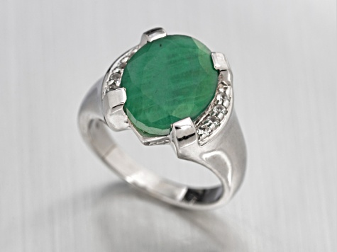5.75ct Oval Sakota Emerald With .16ctw Round White Topaz Sterling Silver Ring