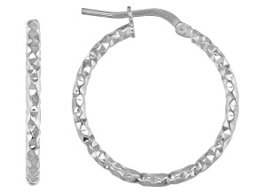 Rhodium over bronze hoop earrings.