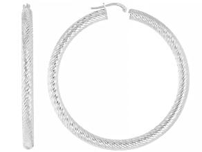Pre-Owned Sterling silver diamond cut round hoop earrings.