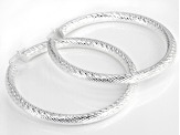 Pre-Owned Sterling silver diamond cut round hoop earrings.