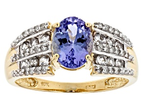 PRE-OWNED 1.43CT TANZANITE WITH .33CTW WHITE SAPPHIRE AND .14CTW WHITE DIAMOND 10K YELLOW GOLD RING