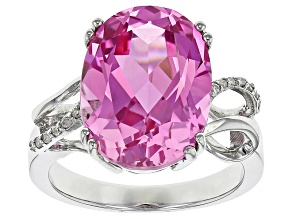 Pre-Owned 12.00ct Oval Lab Created Pink Sapphire With .05ctw Round White Diamond Accents Sterling Si