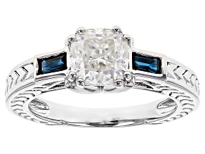 Pre-Owned Moissanite Fire® 1.30ct DEW Cushion Cut With .34ctw Baguette Blue Sapphire Platineve™ Ring