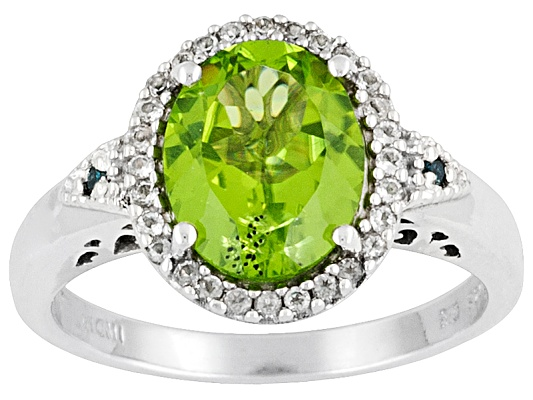 3.12ctw Manchurian Peridot, White Topaz And Blue Diamond Accent Sterling Silver Ring