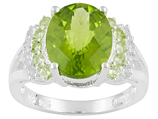 Qinpei Peridot(Tm) 5.24ctw Oval And Round With White Topaz Round Sterling Silver Ring