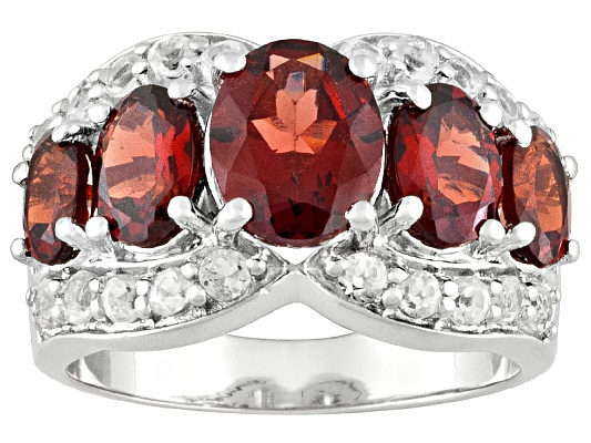 Vermelho Garnet(Tm) 4.99ctw Oval And .87ctw Round White Topaz Sterling Silver Ring