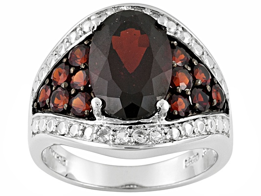 Vermelho Garnet(Tm) 6.20ctw Oval & Round With .55ctw Round White Topaz Sterling Silver Ring